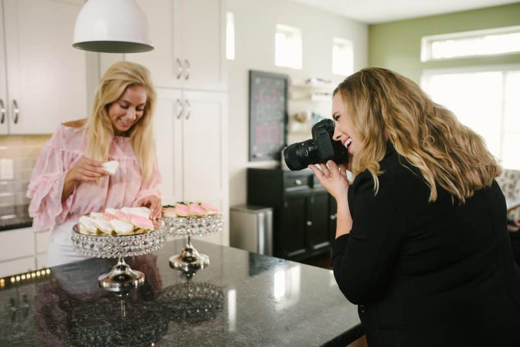 Adrienne Kay photographs a kitchen baking setup during a brand photography session for a client.